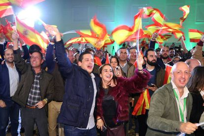 Celebrating the outcome of the election in Seville on Sunday.