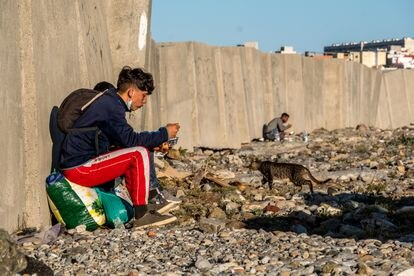 Two young Moroccans on Calamocarro beach in Ceuta.