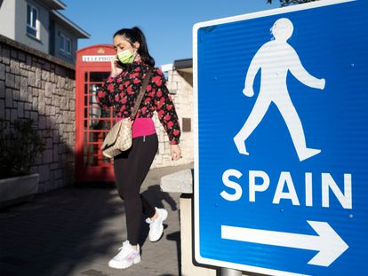 A woman walks along the border separating Gibraltar from Spain.