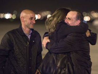 Marc Marginedas (right) is welcomed home by his family Barcelona.