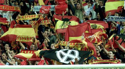 Fans hold up fascist banners during a match at the Bernabéu in 2002.