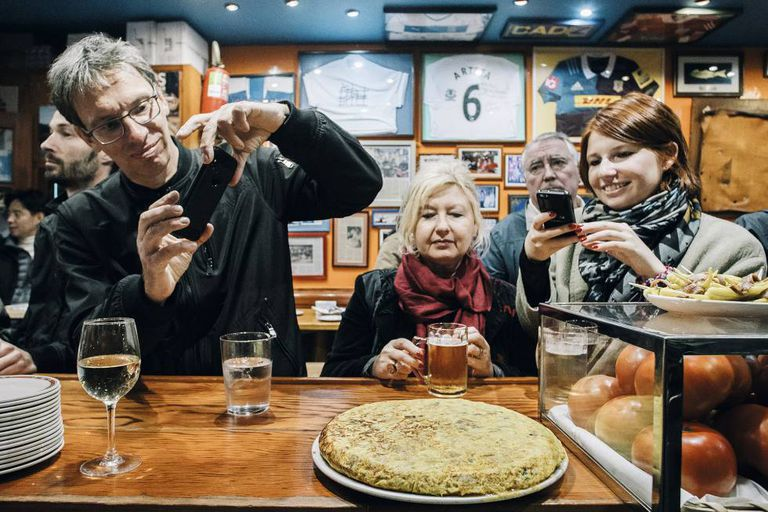 Diners photograph the famous Spanish omelette at Bar Nestor in San Sebastian.
