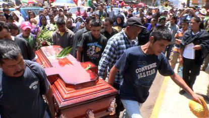 Relatives last month bury a victim of a skirmish between residents in Michoacán state.