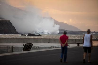 People in La Palma on Wednesday observing the column of smoke rising from the lava as it meets the sea.
