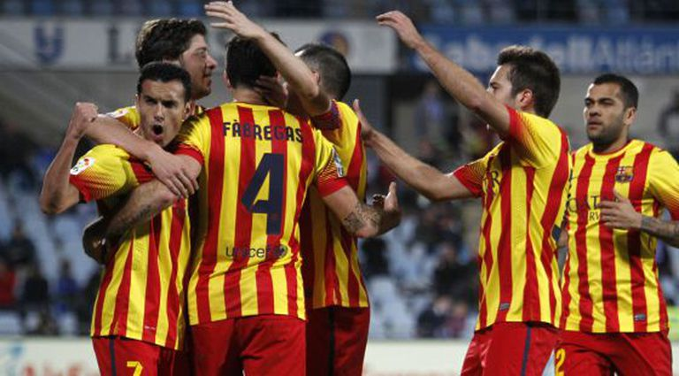 Barcelona players celebrate after one of their five goals against Getafe.
