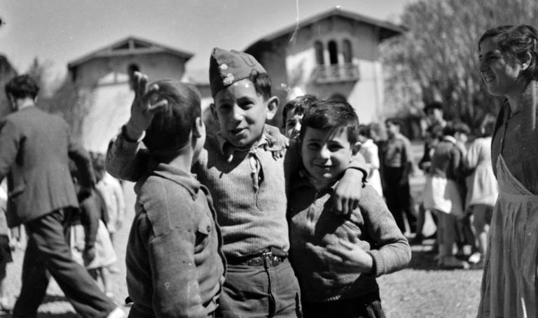 In this newly discovered photo by Kati Horna, three boys play in a palace that had been converted into a school in 1937.
