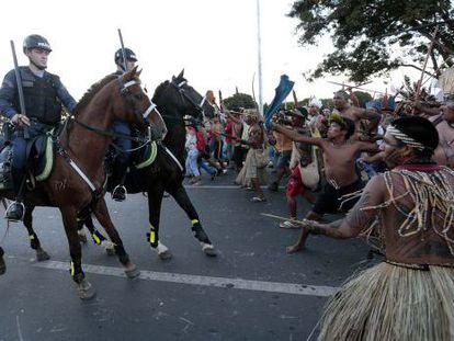 Indigenous protestors clash with police in Brasilia.