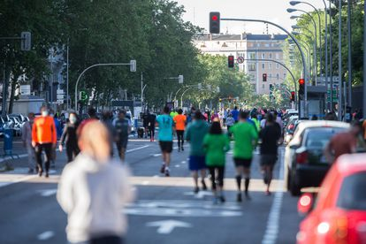 Adults take exercise on a Madrid street at the weekend. During these periods it has been impossible to maintain safe distances in some areas.