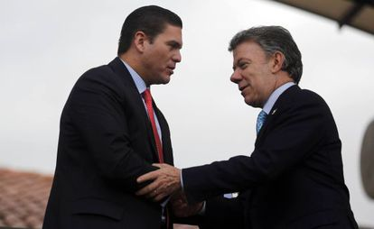 President Santos and former vice-minister of defense, Rafael Guarín.