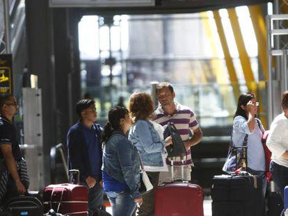 Passengers at Adolfo Suárez Barajas Airport in Madrid.
