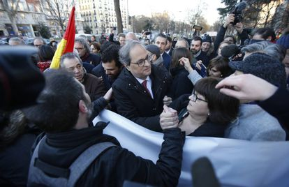 Catalan premier Quim Torra is greeted by pro-independence protesters in the Paseo del Prado boulevard in Madrid.