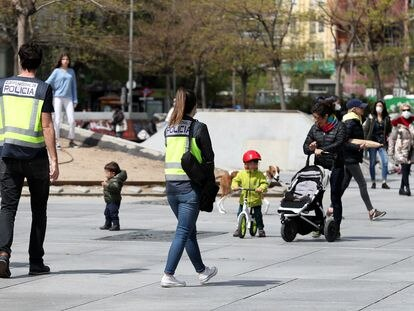 Police on patrol in Madrid on Monday, the second day that children were allowed out onto the street.