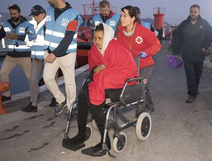 Migrants are assisted by the Red Cross at the port of Motril, in Granada, on Sunday.