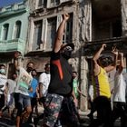People shout slogans against the government during a protest against and in support of the government, amidst the coronavirus disease (COVID-19) outbreak, in Havana, Cuba July 11, 2021. REUTERS/Alexandre Meneghin