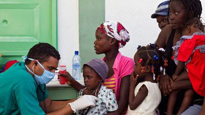 A doctor treats patients in Haiti in 2010.