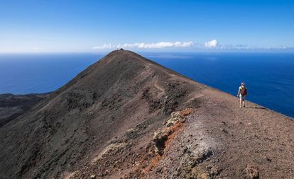 Located on the island of La Palma, this volcano last erupted in 1971 sending 40 million cubic meters of pyroclastic matter into the air. Now visitors can hike up the upper part of the orange-tinged peak, which still continues to emit hot gasses.
