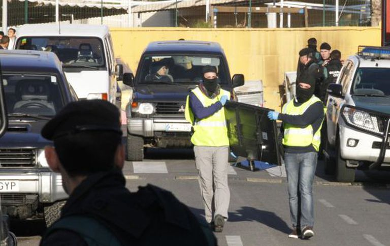 Civil Guard officers conduct a raid in Melilla on Tuesday.