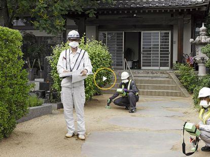 Fukushima council workers take radiation measurements.