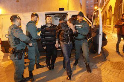 Romanov is escorted by police in Palma de Mallorca.