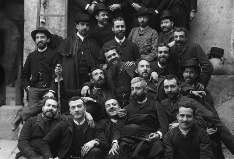 The scientist Santiago Ramón y Cajal in the second row behind the white-haired man, with friends in Valencia around 1885.