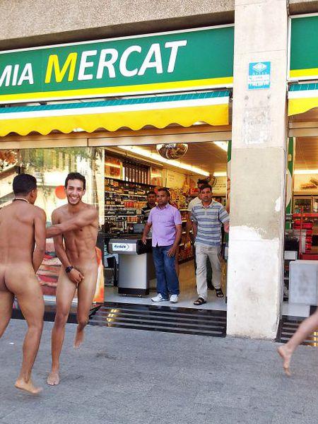 Three Italian tourists running around naked in Barceloneta on Friday.