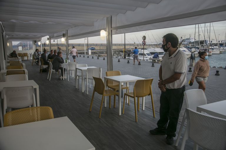 A near-empty restaurant in the port of Corralejo, Fuerteventura in Spain's Canary Islands.