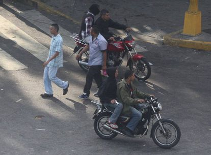 April 8: A group patrols Caracas, openly displaying its weapons.