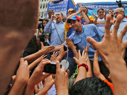 Henrique Capriles (c) greets supporters last Thursday at an rally for candidates running in municipal elections in December.