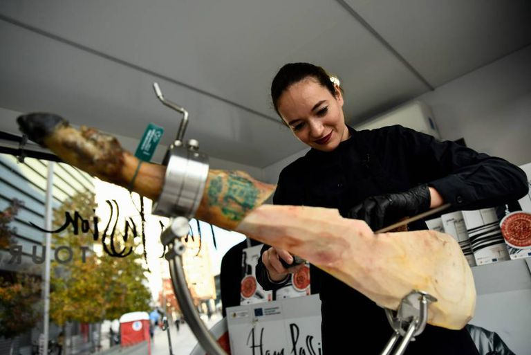 Ham carvers are highly sought after in Spain. Pictured, the specialist Raquel Acosta.