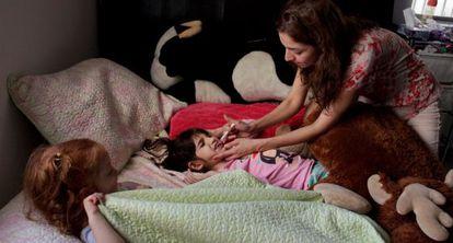 Graciela Elizalde's mother gives her daughter the medication.