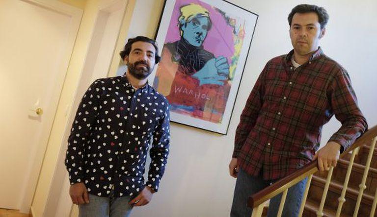 Ricardo Lucas and Iván Vallejo inside their home in Seville.