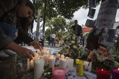 People light candles in Mexico City where Rubén Espinosa and four women were murdered on July 31.