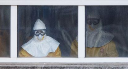 Medical staff in full protective suits treat Ebola patient Teresa Romero on the sixth floor of Carlos III Hospital in Madrid.