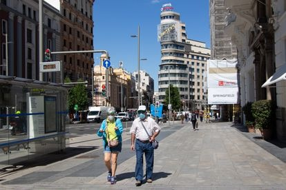 Passers-by with face masks on Madrid's Gran Vía earlier this month.