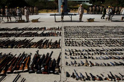 Mexican military displays guns confiscated from drug trade in Tijuana.