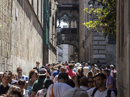 Tourists filling up Barcelona's Gothic neighborhood.