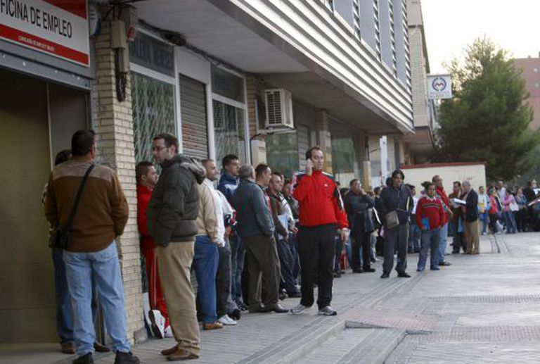 Lines outside an unemployment office in Madrid's Santa Eugenia neighborhood.