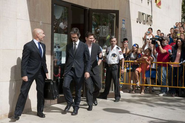 Messi leaves court after appearing before a judge over tax fraud allegations in September 2013.
