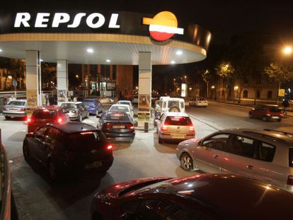 Drivers wait in line at a Repsol gas station.