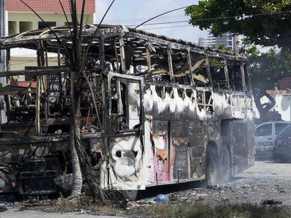 A burned-out bus in the city of Navidad.