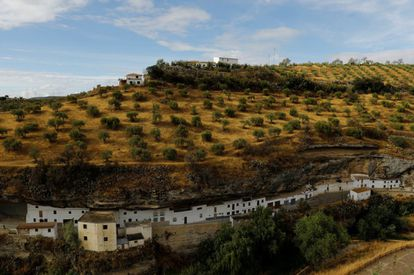 The white village of Setenil de las Bodegas, famous for its distinctive houses built into rock faces along a narrow river gorge.