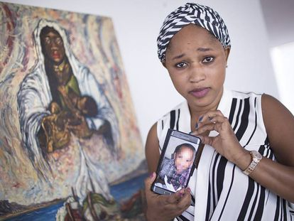Mariam Berete with a photo of her biological son.