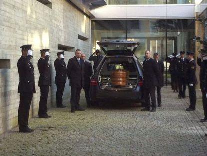 The coffin with the remains of the police officer who died during a shootout with a bank robber on Friday.