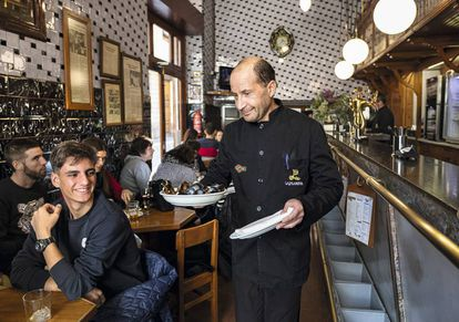 A waiter from La Pilareta, in Valencia, serves clòtxines, or 'true mussels' from the Mediterranean.