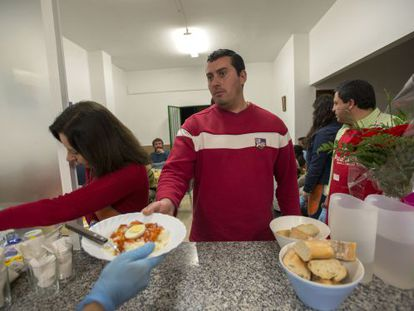 Antonio Luque, an unemployed electrician, stands in line at a soup kitchen in Jaén.