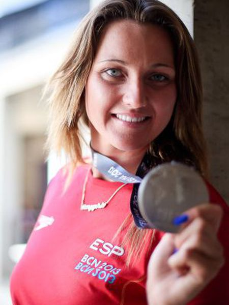 Melani Costa shows off her silver medal.