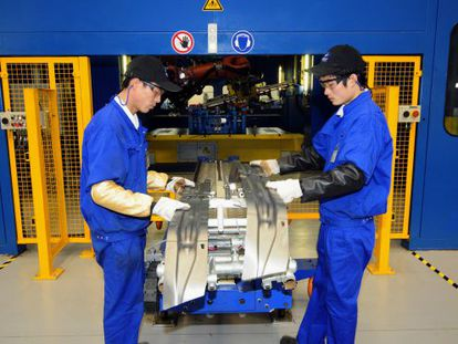 Workers at a factory belonging to Spanish firm Gestamp in Jiangsu.