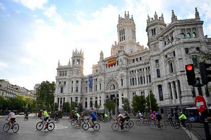 Cyclists ride past Madrid's Cibeles Palace on Saturday.