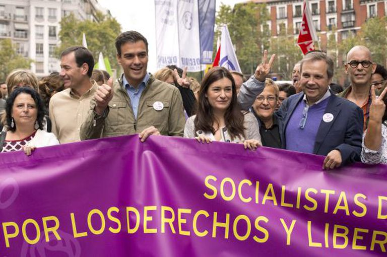 Socialist leader Pedro Sánchez (third from left) marches in Madrid to celebrate the end of the abortion reform.