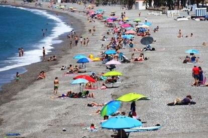 Beachgoers in Almuñécar, Andalusia on Saturday.